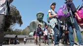 shu : School children are photographed against the backdrop of the Great Buddha in Kamakura, Japan Stock Footage