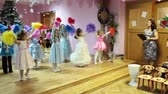 christmass : SAINT-PETERSBURG, RUSSIA - CIRCA DEC, 2013: Preschool children are on Christmass carnival with parents as spectators. Russian nursery school, Russia Stock Footage