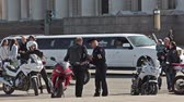 j��zda na kole : Policeman giving traffic ticket for motorcyclist standing with bike, Russia Dostupné videozáznamy