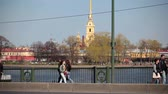 walking : View from Birzhevoy (Exchange) Bridge on Peter and Paul Fortress on Neva river, Sain-Petersburg, Russia Stock Footage