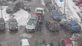 flatbed : Defocusing view of tow truck takeing broken car from the parking lot. Heavy snow. Saint-Patersburg, Russia