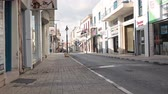 walking : Shops and stores on narrow Arch. Makarios III avenue in the center of Paphos city, Cyrpus