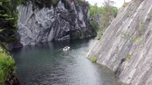 scour : Water walk on rental boat on the flooded marble quarry on circa June, 2012 in Ruskela, Sortavala region of Karelia, Russia