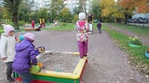 piekne : Children play in sandbox on nursery playground. Autumn season. Russia
