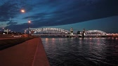 bridge across the river : Embankments of Bolsheokhtinsky Bridge during white nights in Saint-Petersburg, Russia Stock Footage