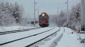 waggon : Freight train passing in winter forest railway, Russia.   There is rear view footage