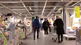 furniture : SAINT-PETERSBURG, RUSSIA - CIRCA JAN, 2015: Customers walk through the Ikea stands in showroom. Ikea marketplace interior with customers walking with shopping cart. Ikea multinational group is the worlds largest furniture retailer. Russian store