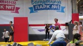 яма : ST. PETERSBURG, RUSSIA - CIRCA OKT, 2015: Sport instructor throws children in pit with foam at kids party. The Jumping Park 1 is in city mall center Leto Стоковые видеозаписи