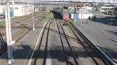 shuttle : NIZHNY TAGIL, RUSSIA-CIRCA YUL, 2015: The arrival of the express passenger train at the station platform in Nizhny Tagil, top view. JSC Russian Railways operating freight and passenger train services Stock Footage