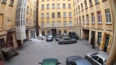 domestic : ST. PETERSBURG, RUSSIA - CIRCA JUN, 2015: Quadrangle small inner yard of residential house with car parking area. Narrow streets are in historical center district Petrogradsky