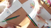 painting : ST. PETERSBURG, RUSSIA - CIRCA MAY, 2015: Children draw on paper while sitting at desks in classroom. Russian daycare center for preschoolers