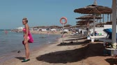 maritime territory : HURGHADA, EGYPT - CIRCA NOV, 2015: First line hotels sea area with sunbeds and parasols is in the Red Sea. Sandy beaches of the Hurghada resort