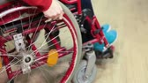 severely : Disabled person turning his wheel chair with hand in room, close up view Stock Footage