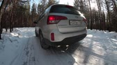 weather : Wide angle view at car driving away in winter forest, country dirt road