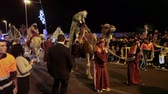 soir??e dansante : LOS CRISTIANOS, TENERIFE, SPAIN - JAN 5, 2016: Fancy dressed people walk on the road. The Cavalcade of Magi is a traditional parade of kings in all Spanish cities.