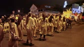 ada : LOS CRISTIANOS, TENERIFE, SPAIN - JAN 5, 2016: Dancing beautiful women in tunics take part in procession on the street. The Cavalcade of Magi is a traditional parade of kings in all Spanish cities.