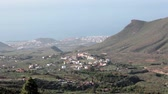 vale : Camera zoom in to Atlantic ocean coast with Las Americas cityscape. Aerial view. South of Tenerife island, Canary, Spain