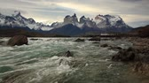 torres : Mountain river at sunset with a view of the mountains. Torres del Paine, Chile Vídeos