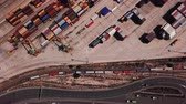 vykládání : Industrial Cargo area with container ship in dock at port, Aerial view Dostupné videozáznamy