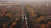Cargo train at sunrise in the fog. View from the drone Stock mozgókép