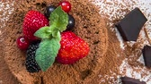 black currant : Chocolate fondant lava cake decorated with strawberries and cocoa powder Stock Footage