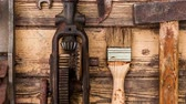 entusiasta : Old vintage hand tools on wooden background Filmati Stock