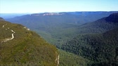 naturalistic : Endless and dense forest between mountains. Blue mountains national park. Aerial top view. Stock Footage