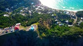 motivação : Lighthouse standing on a mountain above a small city in Australia Forest. Beach. Aerial top view
