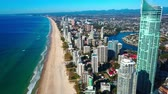 naturalistic : Skyscrapers on the ocean. Quay of the city. Forest. Beach. Aerial top view Stock Footage