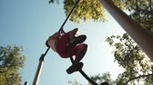 Man climbs the rope. Street workout. Full shot. Backlight Videos