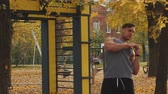 bederní : Young athlete warming up before training tilting the body in different directions in autumn park