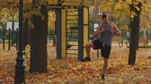 bederní : Young athlete warming up before workout throwing in his feet in the park