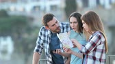 disputa : Three angry lost tourists arguing checking paper map on vacation Stock Footage