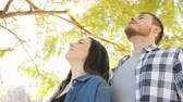 aide sociale : Portrait of a happy couple breathing deep fresh air standing in a park
