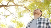 aide sociale : Happy relaxed man breathing deep fresh air standing in a park