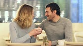 blind : Happy couple kissing in a coffee shop during the first date in the night