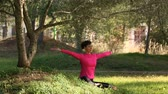 soul searching : woman practicing meditation outdoors Stock Footage