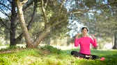 soul searching : caucasian woman practicing meditation in the park