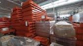 сырье : Warehouse of metal profiles . The orange profile to create the warehouse. metal pipe