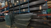 rury : Warehouse of metal profiles . The profile to create the warehouse. metal pipe. boxes, trolleys, metal parts