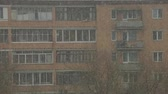 осадки : View of a block under the snowfall