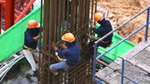vasalás : Construction workers Construction workers and Concrete reinforcement