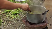 нержавеющая сталь : Cooking Food over Thai traditional charcoal burning old stove, Thai traditional cooking, Thai lifestyle.