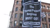 választotta : TRUMPPENCE REGIME Sign. Protest sign calling for an end to the Donald Trump presidency on June 2nd, 2018 at the Rally for Justice in downtown Los Angeles, California. Stock mozgókép