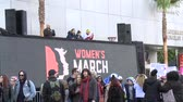 kurtuluş : Womens March LA, Wide. Giant LCD billboard at the Womens March in Los Angeles, California on January 21st, 2017, the day after Donald Trumps presidential inauguration. Stok Video