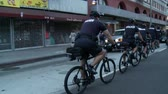 martin : Police Follow Protest on Bikes. Police officers follow protesters on bike at a rally in downtown Los Angeles, California on July 16th, 2013. Stock Footage