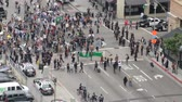 Crowd Control, Zoom Out. Protesters for the Occupy Movement gather near a police blockade in downtown Los Angeles, California on May 1st, 2012. Stock Footage