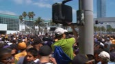 LA Lakers Parade at Staples Center. Camera pans across a massive crowd on the street in front of Stapes Center in Los Angeles, waiting for the 2010 Lakers Championship parade to pass through. Stock Footage