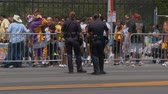 Police Hold the Line. Group of female police officers guard a barricade following the 2010 LA   Lakers Championship parade on June 21st, 2010, Los Angeles, California. Stock Footage