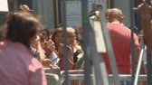 morrer : Fans Photograph Jackson Memorial. Fans gather to remember Michael Jackson at his star on the Hollywood Walk of Fame the day after his death in Los Angeles, California on June 26th, 2009. Stock Footage